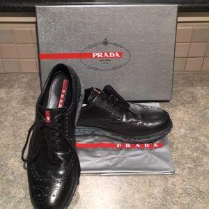 Prada dress tennis shoes in black.